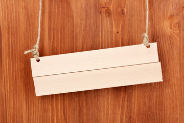 Wooden signboard on wooden background