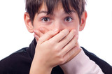 Two hands covering mouth of surprised teenager