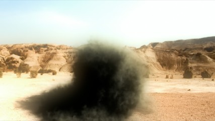 Camera operator view (handheld) of bomb fall in the desert