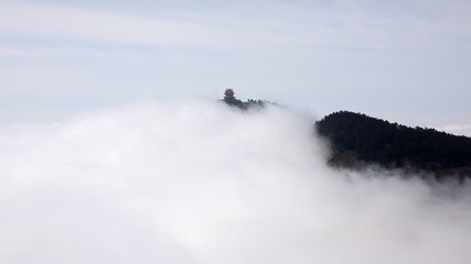 Beautiful chinese pagoda in hi cloudy mountains