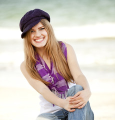 Funny teen girl near the sea.