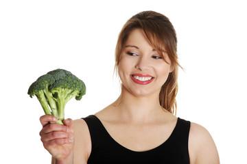Woman with broccoli