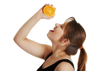 Woman squeezing fresh orange