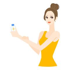 日焼け止めを塗る女性