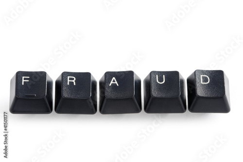 computer keys spelling the word fraud on white