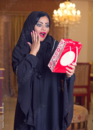 beautiful arabian lady happy for receiving a gift