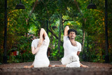 Couple yoga gomukhasana cow pose