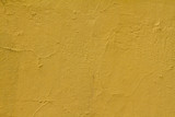 Piece of yellow wall useful for a background