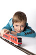 boy playing with a train