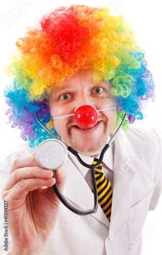 Funny clown doctor with stethoscope