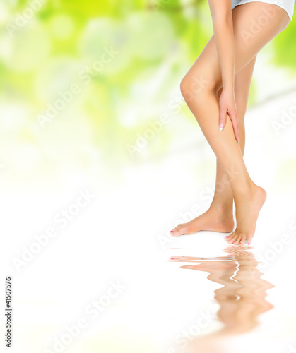 legs being massaged reflected in water