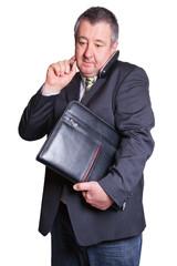 Mann mit Aktentasche telefoniert
