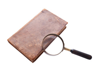 antique book and  magnifier