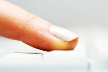 Female finger typing on computer keyboard