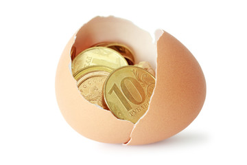 Coins in broken eggshell