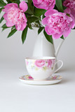 Teacup and pink peonies
