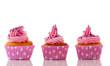 Pink cupcakes with purple sprinkles