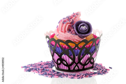 Pink cupcake with rose flower