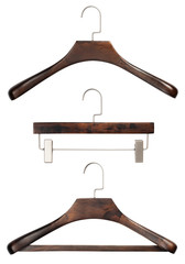 Closeup of set of various luxury brown wooden clothing hangers