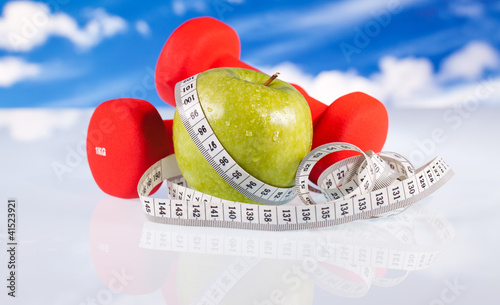 fitness dumbbells  apple and measure tape