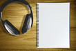 notebook and headphones
