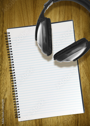 notepad and headphones