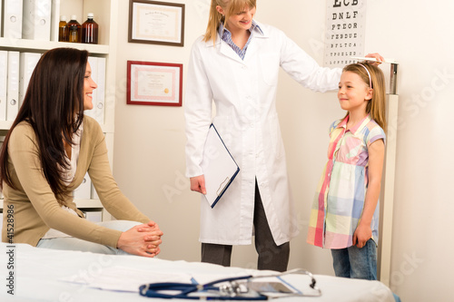 Medical check-up pediatrician girl measure height