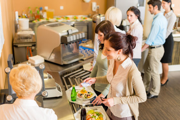 At the cafeteria woman pay bill