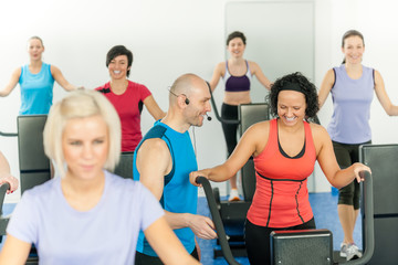 Fitness instructor leading class of alpinning