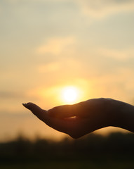 The sun in hand