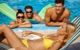Attractive female and companionship by pool poster
