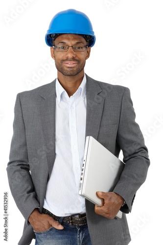 Elegant engineer with laptop