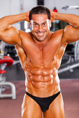 happy male bodybuilder in gym