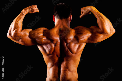 rear view of bodybuilder top