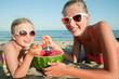 Summer  beach - girls eating watermelon on the beach