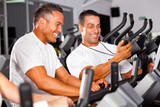 Fototapety fitness man and personal trainer in gym