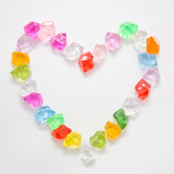 symbol of heart made of translucent colorful stones.