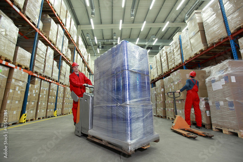 warehousing - workers in uniforms  working in storehouse