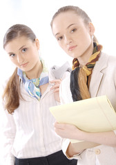Portrait of two beautiful young female business executives