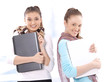 Portrait of smiling beautiful female students with notebooks