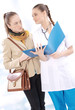 Female medical doctor and her patient discuss test results