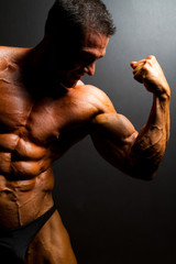 muscular bodybuilder on black background