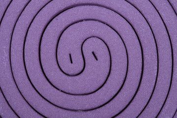 Close up Purple mosquito spiral coil.