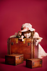 A beautiful young girl lying on wooden treasure trunk