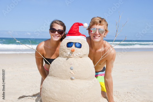 Couple having fun at beach with sandman