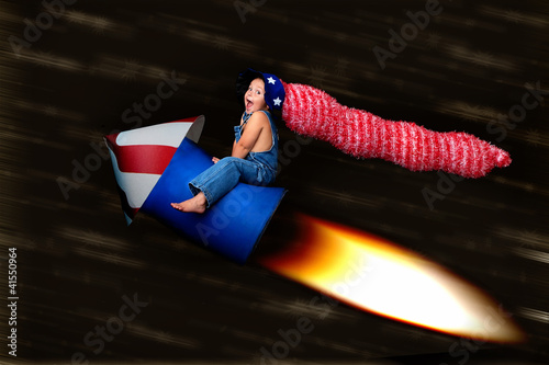 Patriotic Blast Off:  young boy on rocket