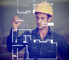 Construction worker sketching blueprints