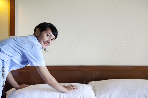 Asian maid working in hotel room