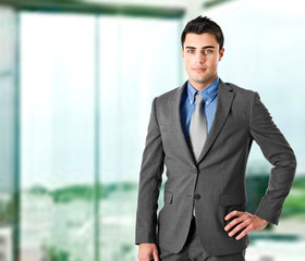 Young businessman portrait in his office