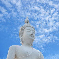 White Buddha statue and blue sky